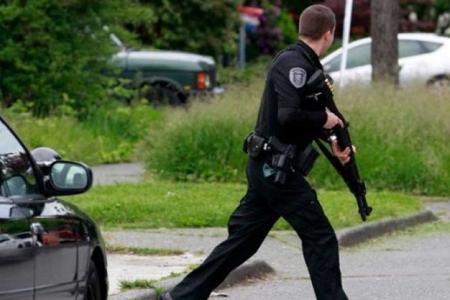 ABŞ-da atışma olub, bir polis zabiti ölüb, biri yaralanıb
