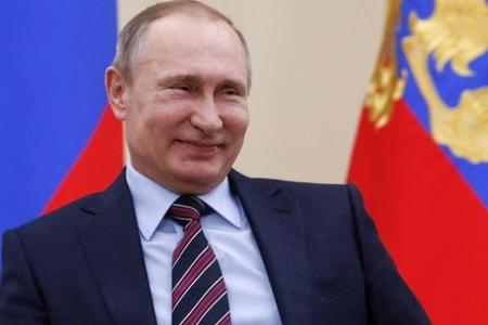 Vladimir Putin: 90-cı illərdə silahla yatırdım