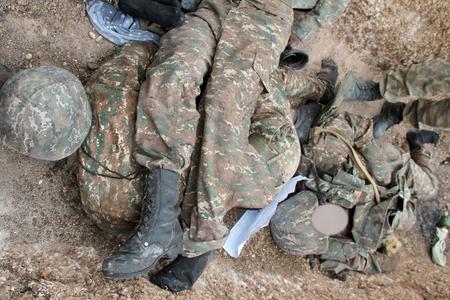 Daha iki erməni hərbçisinin meyitinin qalıqları tapılıb-
